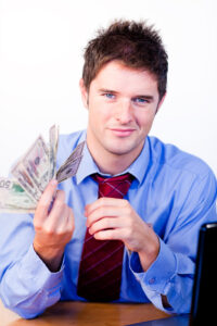 Businessperson holding money